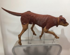 Col Suggett - Red Dog Stalking (kinetic) 2015 - Cane, cloth, wood, paint, mechanical and electrical components. Price - POA