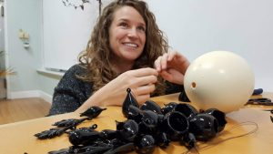 Sarah Dingwall in the process of assembling her 'in waiting' - borosilicate glass, found objects, egg